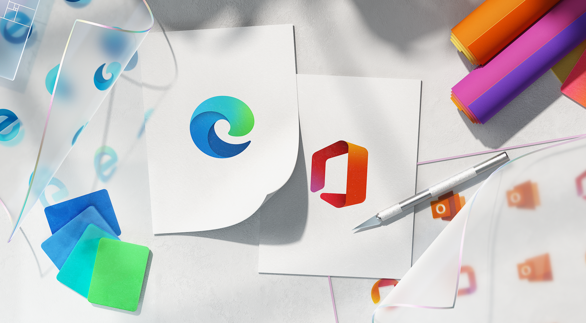Microsoft redesigns its icons, A designer's desktop covered with icon materials and drawings.