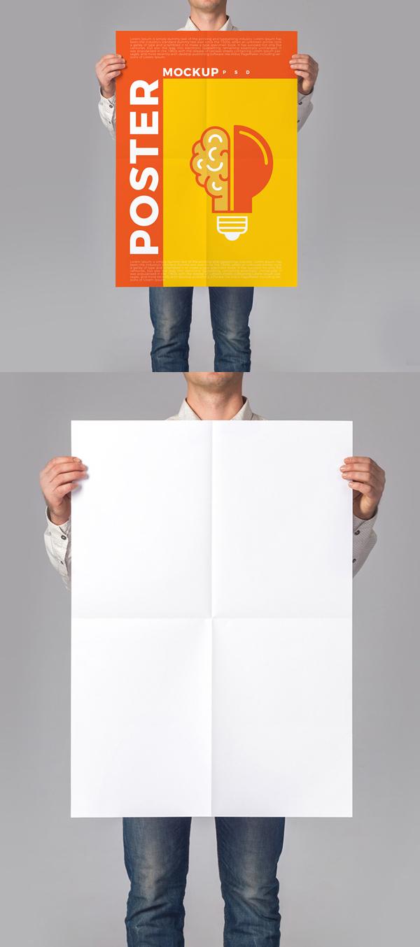 Man Holding Poster Mockup Free PSD